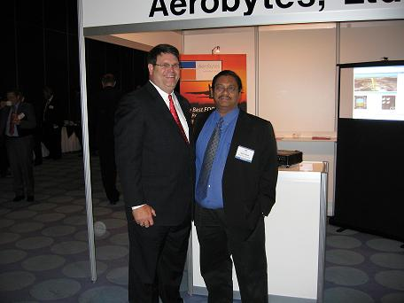 Bob Whetsell, Aerobytes with a visitor to exhibition stand